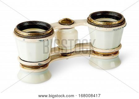Old vintage pair of opera glasses vertically flipped isolated on white background