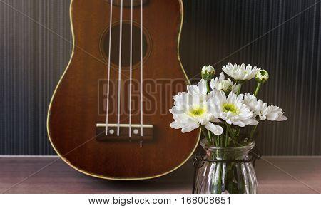 White Flower And Ukulele Background In Vintage Mood