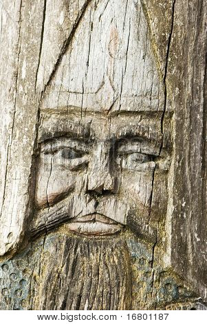 face of hero, glyphic on wood