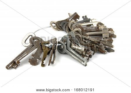 A bunch of old keys lying isolated on white background