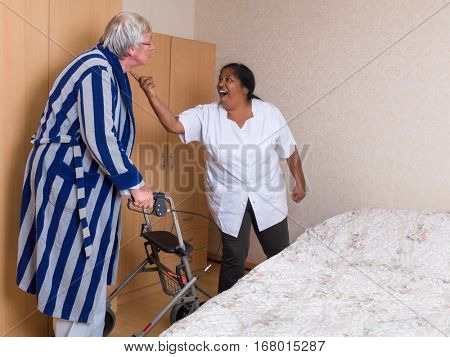Funny scene of an elderly man having a discussion with his nurse