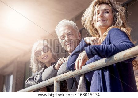 Attractive People Waiting At The Bus Stop