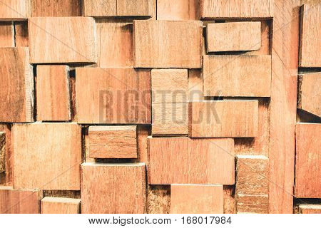 Weathered stoned wood background and alternative construction material - Wooden blocks textured stonewall panel on fashion design - Carpentry concept with retro old fashioned backdrop woodwork pattern