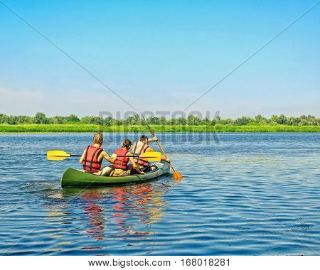 Journey down the river on a sunny day in a canoe