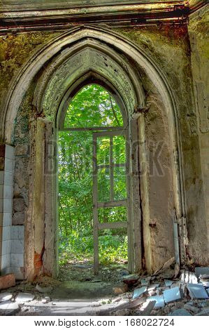 Old rotten doorway of an abandoned mansion of Khvostov in gothic style, Lipetsk region