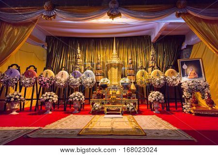 Bangkok, Thailand - December 17, 2011: The Funeral Urn of Phra Phrom Kawee (Worawit Khongkhapunyo) between with the royal wreath in Wat Moli Lokayaram Ratcha Worawihan opened for Buddhist mourners to pay respect.