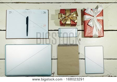 Objects and gadgets for buiness planning and two packed gifts