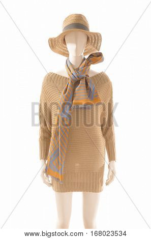 women brown dress with hat, scarf on dummy