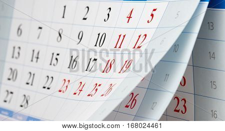 Flipping of three sheets of calendar with black and red numbers