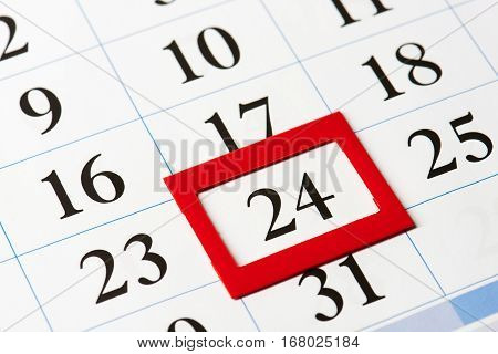 Calendar date highlighted in red close-up macro