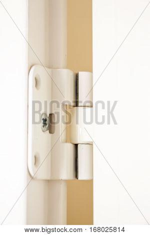 White door hinge on white door closeup