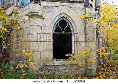 Old rotten window of an abandoned mansion of Khvostov in gothic style, Lipetsk region