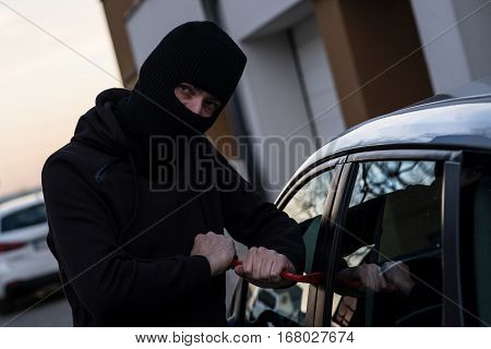 Auto Thief In Black Balaclava Trying To Break Into Car