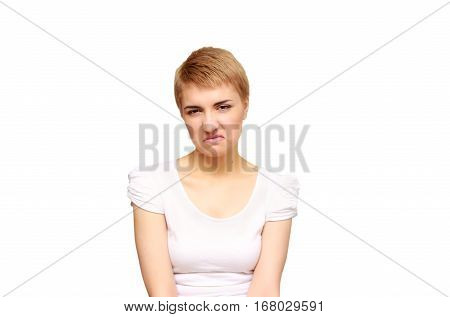 portrait skeptical, upset young woman looking suspicious, disgust on face, mixed disapproval, isolated white background. Negative human emotion, facial expression, feeling, attitude