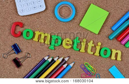 The word Competition on cork background closeup