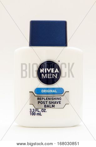 New York, January 25, 2017: A bottle of Nivea post shave balm stands against white background.
