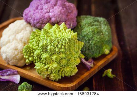 Fresh Organic White And Purple Cauliflower, Broccoli, Romanesco