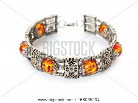 Rich decorated silver bracelet with amber. Bijouterie imitation jewelry.