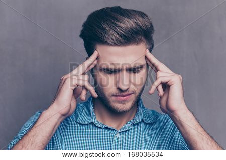 Young Sad Thoughful Man Having Headache After Work