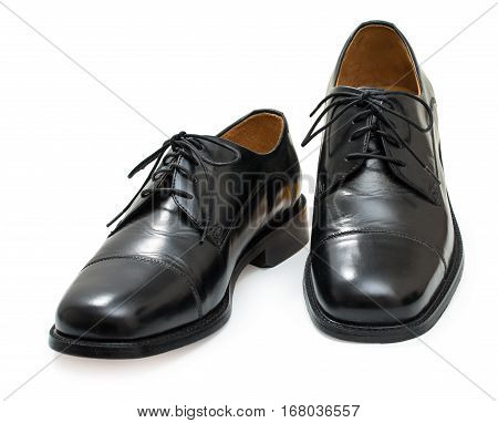 Pair of elegant mens shoes. Fashion black shiny leather. Isolated on a white background.