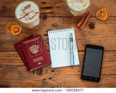 Passport, Notebook And Cup Of Coffee