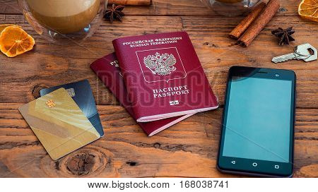 Credit Cards, Passport, Notebook, Cup Of Coffee On Wooden Table
