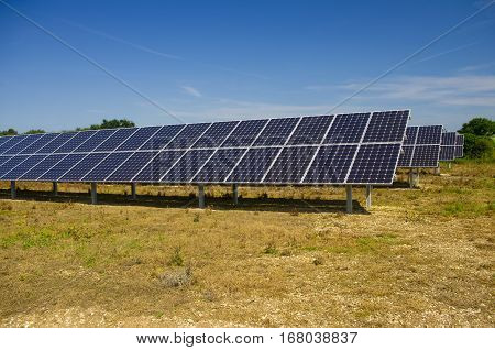 Solar Power Farm Solar Panel Farm, producing green renewable  electric energy from the sunlight.