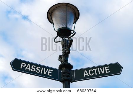 Passive Versus Active Directional Signs On Guidepost