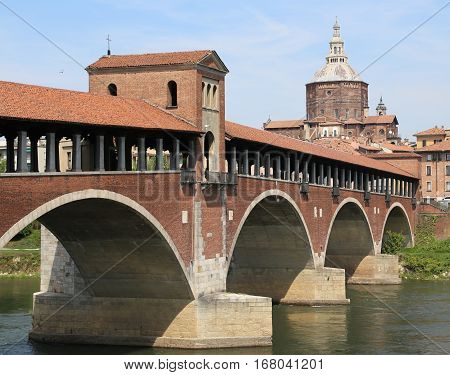 Covered Bridge Over The Ticino River In Pavia City In Italy