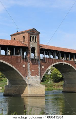 Historical Covered Bridge Over The River In Pavia