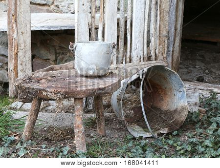 Abandoned Barn An Old Broken Bucket  And An Aluminum Pan On The