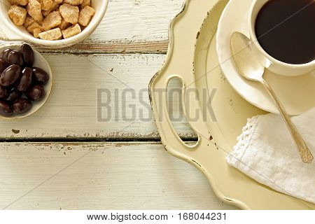 Charming vintage table setting with coffee, almonds and sugar cubes. . Open space for background