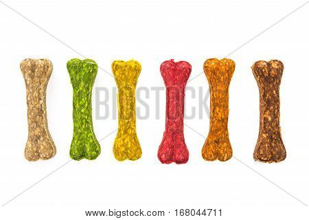 multicolored stone. treats for dogs on a white background