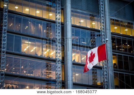 Canadian flag in front of a business building in Toronto
