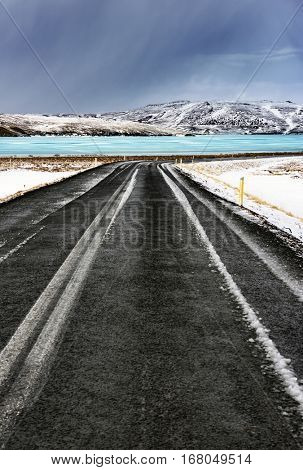 Frozen lake view, beautiful winter landscape, cold extreme weather, road trip to Iceland, winter time holidays in Scandinavia, escape concept