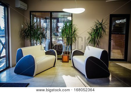 Luxury lobby interior.With crystal lamp, bing hall, marble floor, french sash, mosaic tile, comfortable sofa, reception