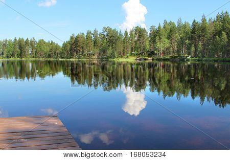 Typical Finnish houses in the woods near lake Karelia