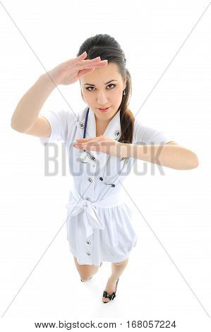 Young medical doctor woman presenting and showing copy space for product or text. Female medical professional isolated on white background.
