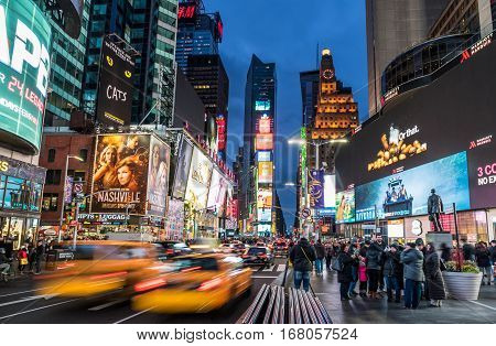 New York NY USA- Jan 28 2017. Time Square by night with crowds of tourists and LED signs lighting up the place.