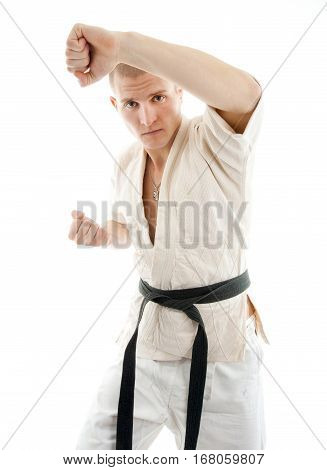 Karate. Man in a kimono on the white background
