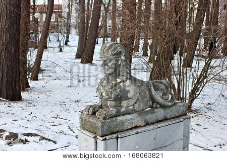 The sculpture of the small sphinx with a woman's face at the entrance to the city park in Svetlogorsk (Rauschen). Made in 30s of the 20th century from artificial stone.