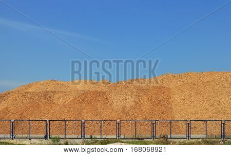 Wood Chip Mountain under Clear Blue Sky