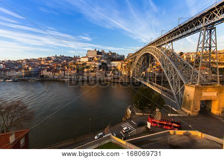 PORTO, PORTUGAL - JAN 11, 2017: View of Douro river and Dom Luis I bridge. City of Porto won the European Best Destination 2012 and 2014 awards.