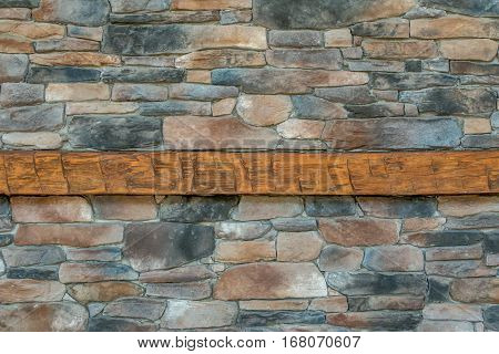 rocky background with wood mantle in the middle