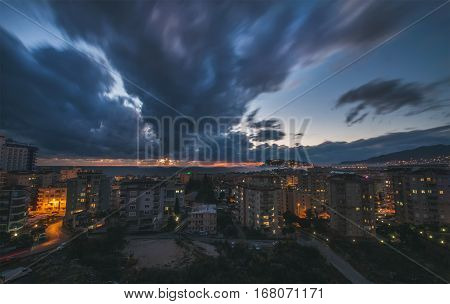 ALANYA, ANTALYA PROVINCE, TURKEY - DECEMBER 31: View over dramatic clouds in the sky over the Mediterranean sea at sunset in winter from viewpoint in Tosmur district of southern turkish town Alanya