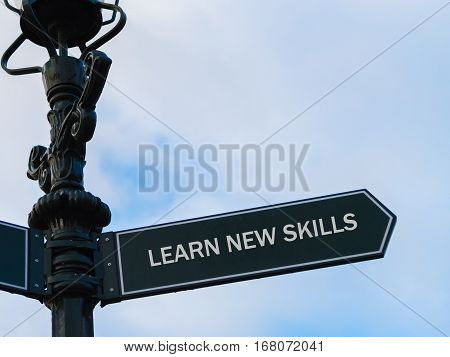 Learn New Skills Directional Sign On Guidepost