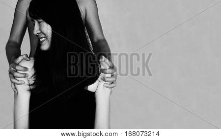 Hand Holding Shoulder Of Fear Woman On White (abuse Concept)