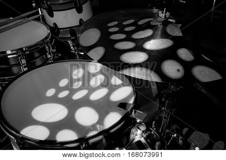 Close up of drum with lights shining on drum