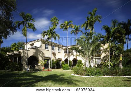 Stock photo of a single family home in South Florida built in the 1950's on a blue sky