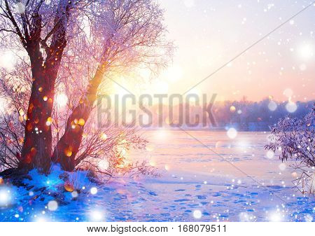 Beautiful Winter landscape scene background wit snow covered trees and ice river. Beauty sunny winter backdrop. Wonderland. Frosty trees in snowy forest. Tranquil winter nature in sunlight.